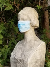 masked statue